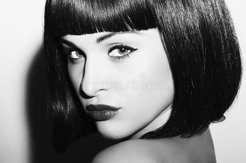 Monochrome portrait of Beautiful Brunette Girl. Healthy Black Hair. bob Haircut. beauty woman royalty free stock image