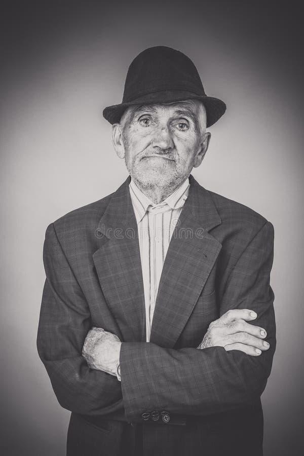 Monochrome portrait of expressive old man stock images