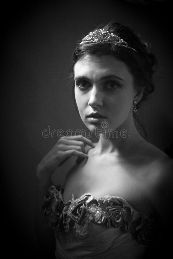 Monochrome portrait of woman in vintage attire royalty free stock photography
