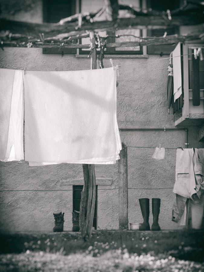 Monochrome shot of laundry getting dry stock photo