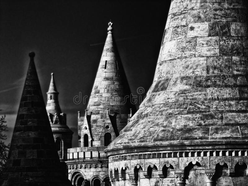 Monochrome stone turret detail of the Fisherman`s Bastion in Budapest. Black and white architectural stone turret detail of the Fisherman`s bastion in Budapest stock photos