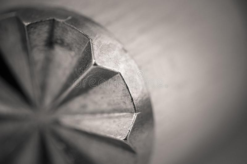 Monocrome macro shot of a wooden meat tenderizer, metal end. Kitchen royalty free stock photography