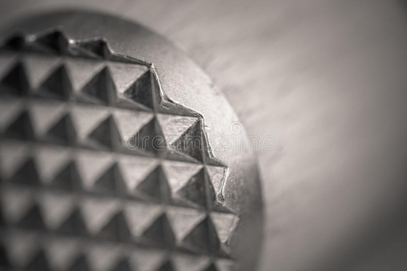Monocrome macro shot of a wooden meat tenderizer, metal end. Kitchen stock photo