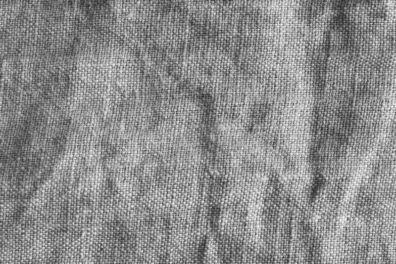Monocromio del primo piano della struttura del tessuto naturale immagini stock