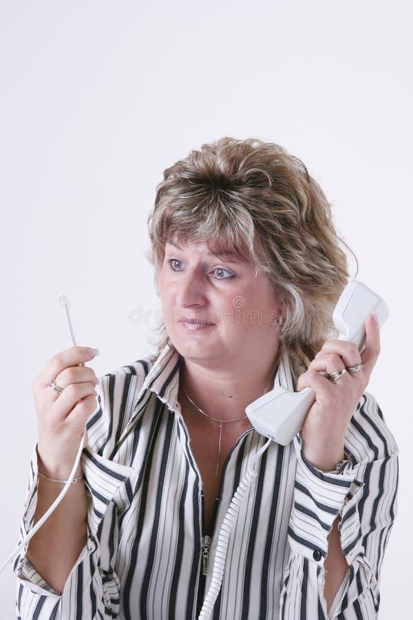 Monofone da terra arrendada da mulher foto de stock