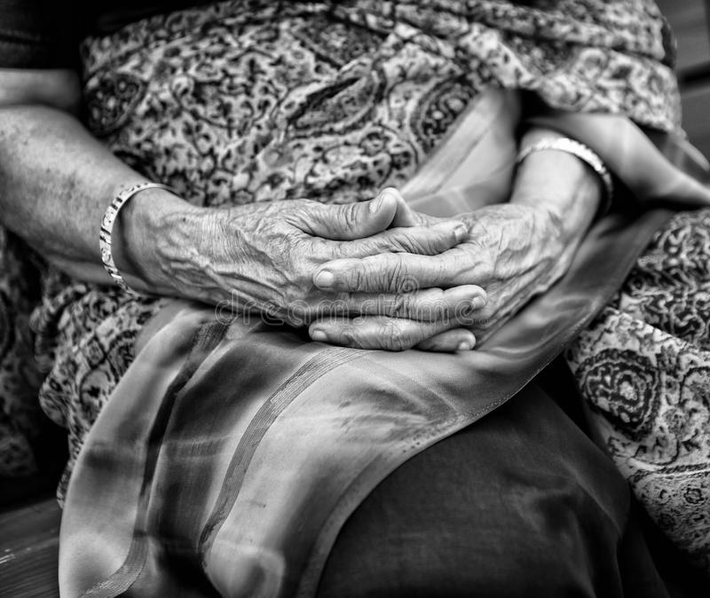 Monohrome image of old wrincle hands royalty free stock photo