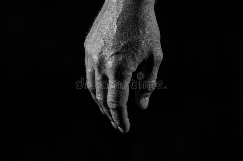 Monokrom bild, trött caucasian manlig hand arkivfoto