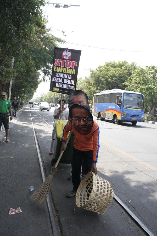 Monologue action Work And Stop Euforia. Election of Joko Widodo Solo became president make citizens proud but not euphoric action requested artists and get back stock image
