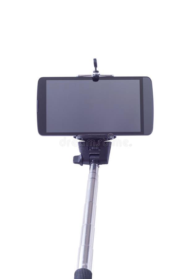 Monopod et téléphone portable de Selfie photographie stock libre de droits