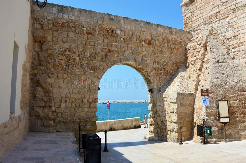 MONOPOLI, ITALY - AUGUST 4, 2017: view of arch of the castle in Monopoli, Apulia region, Italy stock images