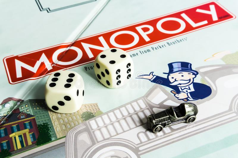 Monopoly Board Game - Board, dices and Car Token. Monopoly Board Game close up with Board, dices and Car Token. The classic real estate trading game from Parker stock images