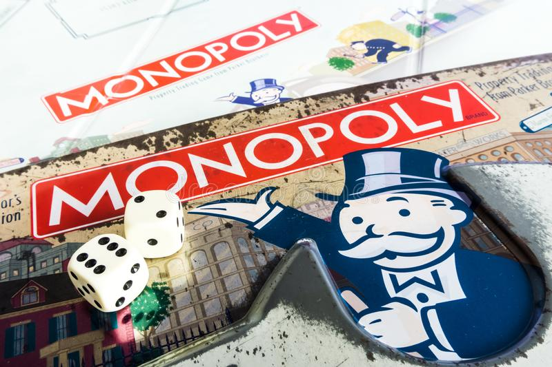 Monopoly Board Game - Box, Dices and Board close up. Monopoly Property Trading board game from Parker Brothers. The classic real estate trading game from Parker royalty free stock image