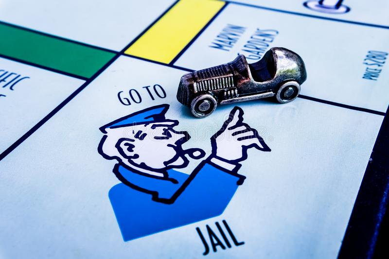 Monopoly Board Game - Car Token GO TO JAIL. Monopoly Board Game close up with the car passing the GO. The classic real estate trading game from Parker Brothers stock images
