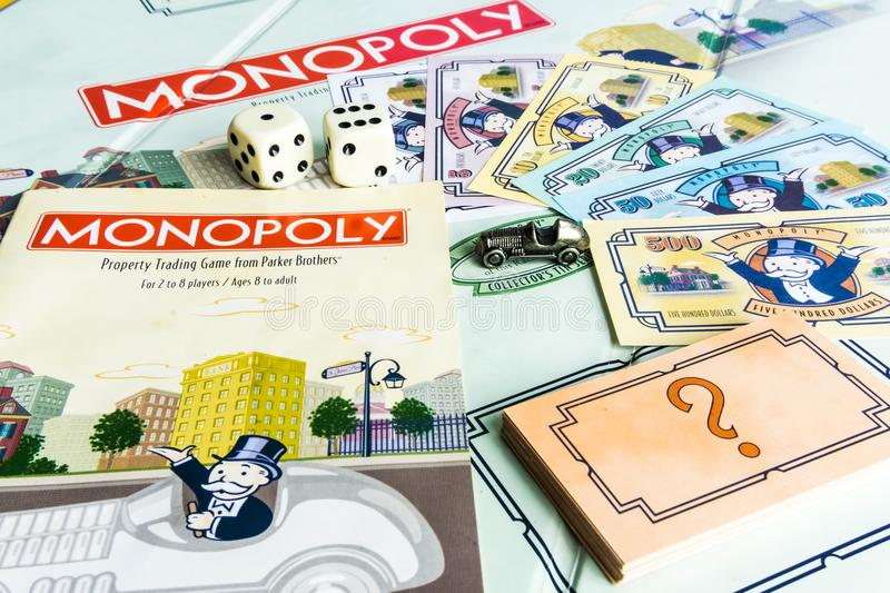 Monopoly Board Game - Come with Game Instruction. Monopoly Property Trading board game from Parker Brothers. The classic real estate trading game from Parker royalty free stock images