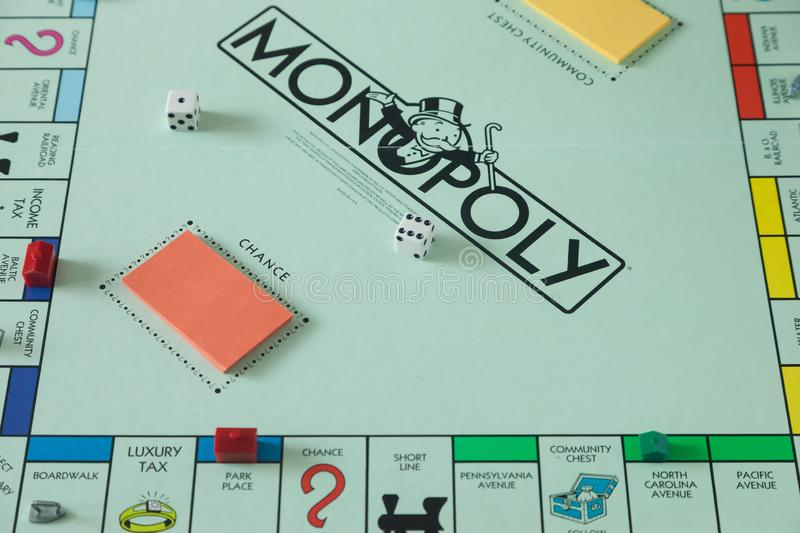 Monopoly Board Game Details. WOODBRIDGE, NEW JERSEY - October 11, 2018: A view of a circa 1980s Monopoly board game royalty free stock images