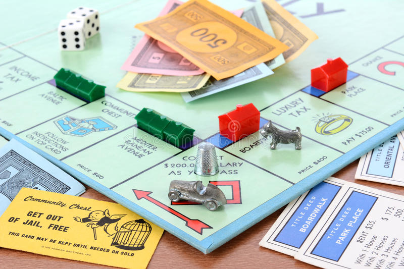 Monopoly Board Game. IRVINE, CA - MAY 19, 2014: Monopoly Board Game Closeup. The classic real estate trading game from Parker Brothers was first introduced to stock photos