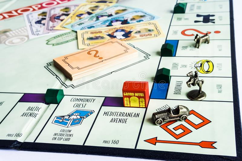 Monopoly Board Game - Money on the Board. Monopoly Property Trading board game from Parker Brothers. The classic real estate trading game from Parker Brothers royalty free stock photo