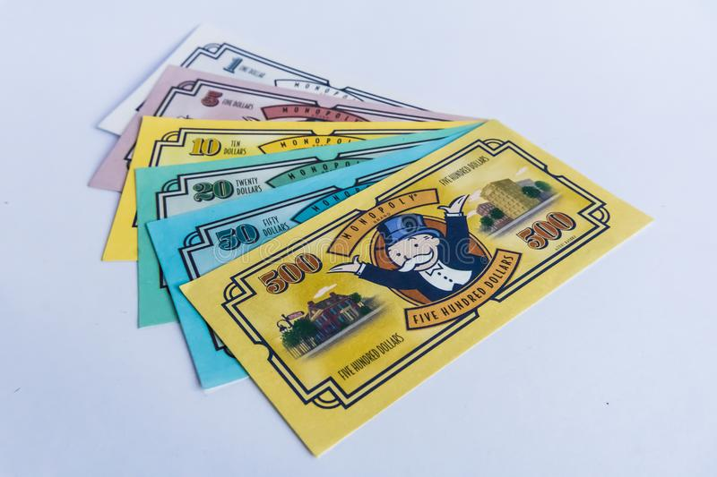 Monopoly Board Game - Money on the desk. Monopoly Board Game with game money on the desk. The classic real estate trading game from Parker Brothers was first royalty free stock image