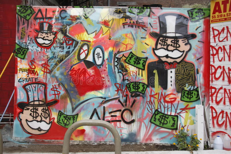 Monopoly, new york city street graffiti. New york city,new york,september 27,2015: graffiti,of the popular board game monopoly.this was done outside a gas royalty free stock image