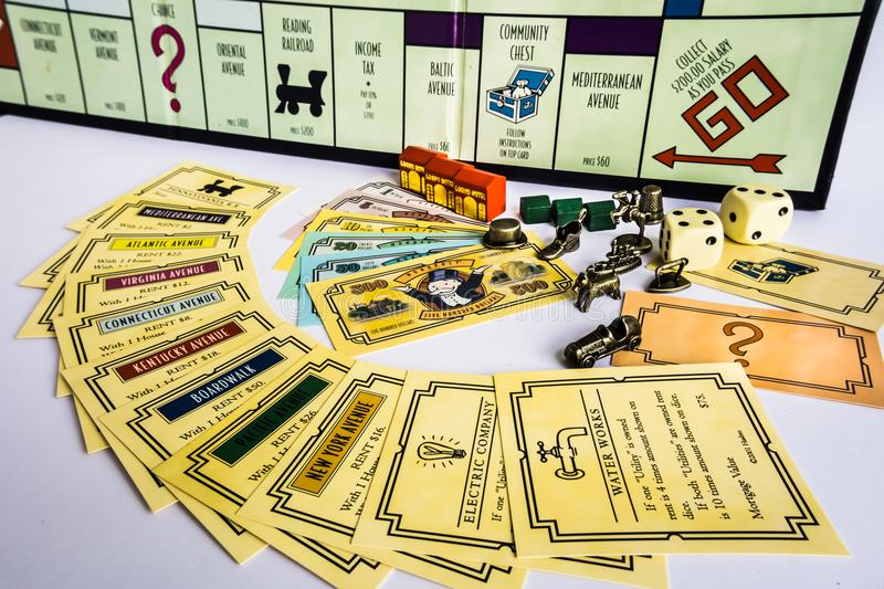 Monopoly Board Game - Equipments. Monopoly Property Trading board game from Parker Brothers. The classic real estate trading game from Parker Brothers was first stock photos