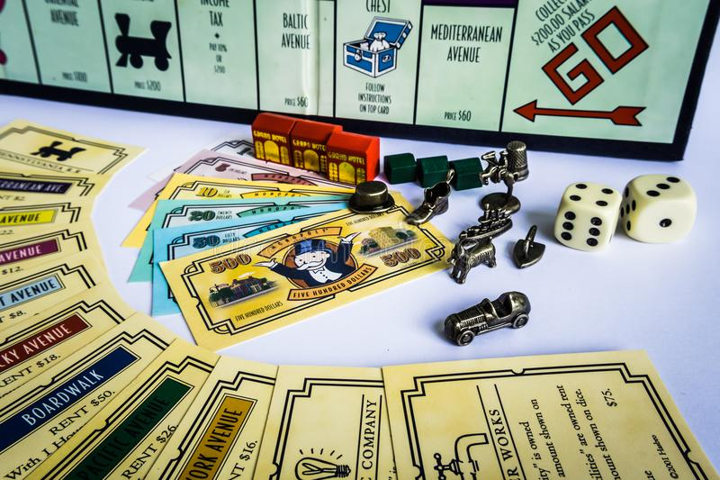Monopoly Board Game - Equipments. Monopoly Property Trading board game from Parker Brothers. The classic real estate trading game from Parker Brothers was first royalty free stock image