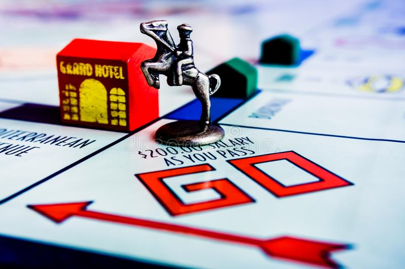 Monopoly Board Game - Horse Token on GO box. Monopoly Property Trading board game from Parker Brothers - Horse Token on GO box. The classic real estate trading stock photo