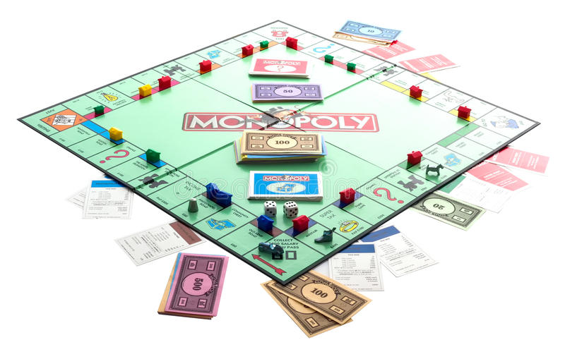 Monopoly. SWINDON, UK - DECEMBER 18, 2014: English Edition of Monopoly, The classic trading game from Parker Brothers was first introduced to America in 1935 royalty free stock photo