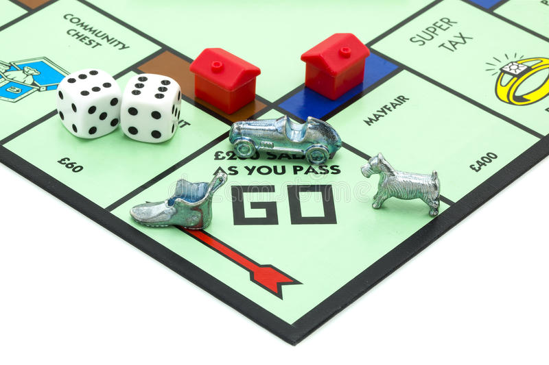 Monopoly. SWINDON, UK - JUNE 11, 2014: English Edition of Monopoly showing Pass Go, The classic trading game from Parker Brothers was first introduced to America royalty free stock image
