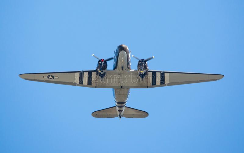 A C-47 cargo aircraft in flight stock image