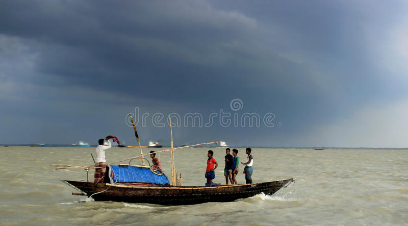 Monsoon in Bangladesh. The life of bangladeshi people is very simple. They live by struggle. The fishermen catch fish in te river. As Bangladesh is a land of royalty free stock photo