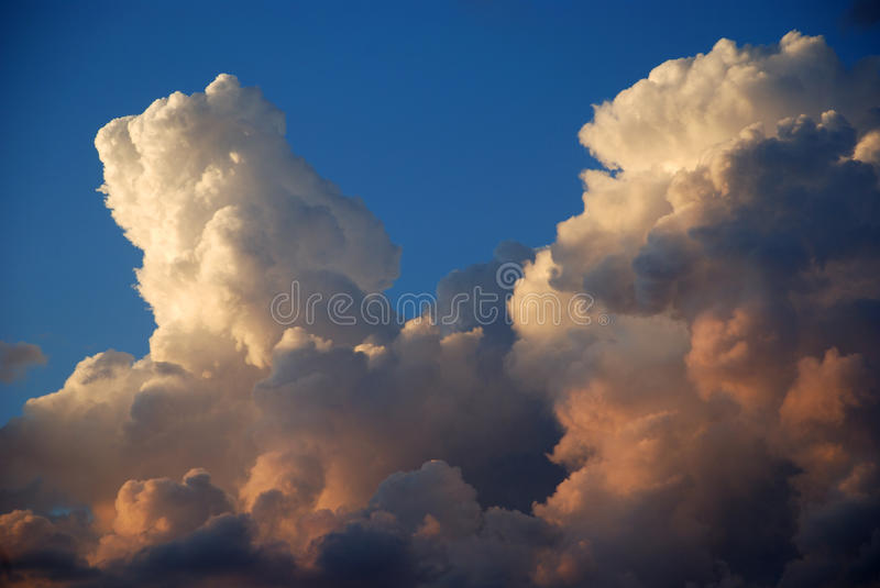 Monsoon Clouds. Clouds billow, turn dusty pink during Arizona's monsoon season royalty free stock images
