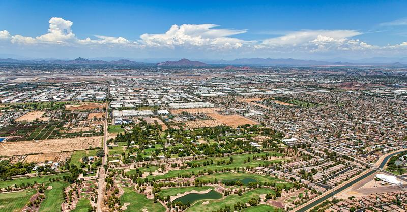 Monsoon Clouds building over the desert southwest. Moonsoon clouds building over airport and golf course in the desert southwest stock image