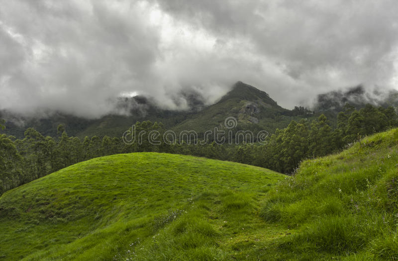 Monsoon clouds over mountains. Monsoon clouds over Western Ghats, South India stock images