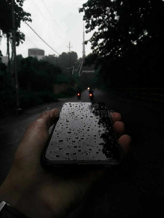 Monsoon rain!. Dark, black, hands, handsintheframe royalty free stock images