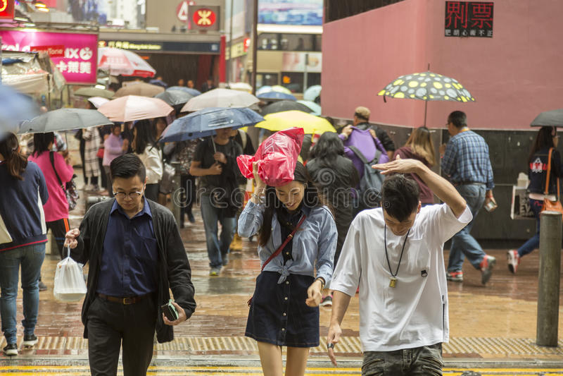 Monsoon rain in Hong Kong. Rainy day in Hong Kong in Mong Kong shopping district. The climate of Hong Kong is a monsoon-influenced humid subtropical climate stock photos