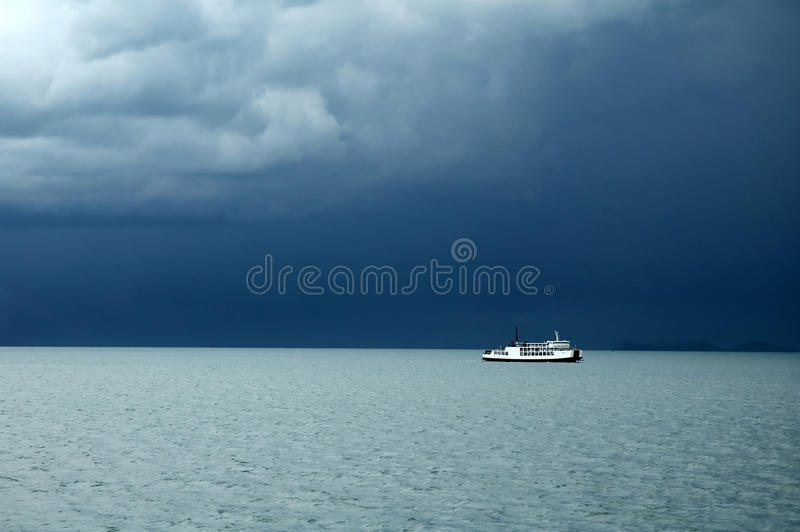 Monsoon season. White ship in monsoon season stock photos