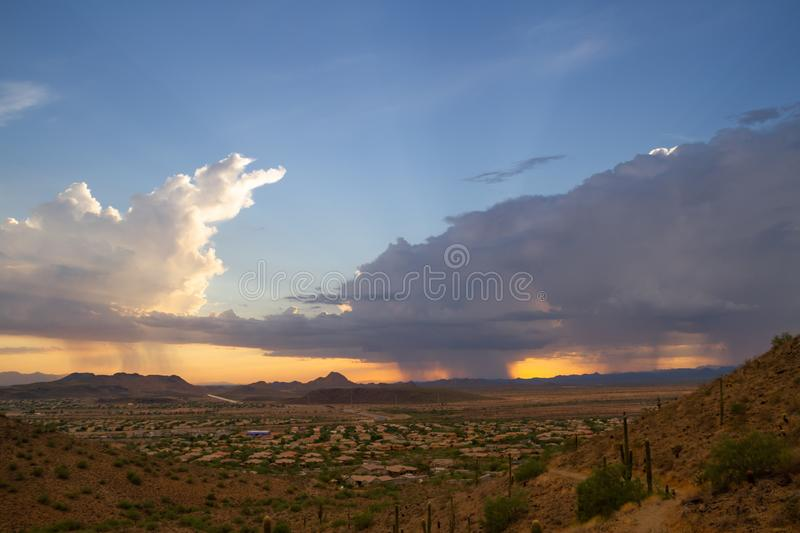 A Monsoon Storm over Arizona. A monsoon storm over the desert of Arizona during sunset stock image