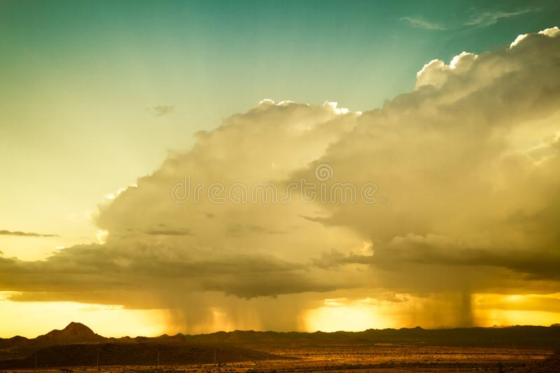 A Monsoon Storm over Arizona. A monsoon storm over the desert of Arizona during sunset royalty free stock photography
