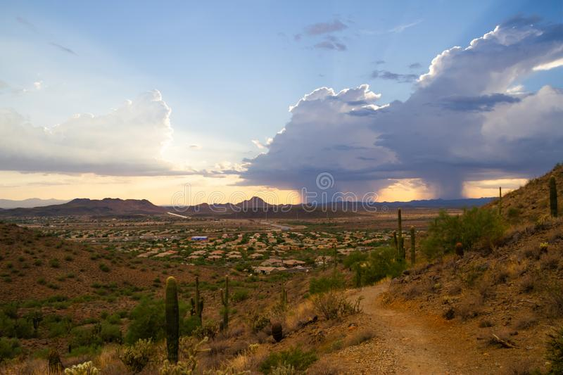 A Monsoon Storm over Arizona. A monsoon storm over the desert of Arizona during sunset stock images