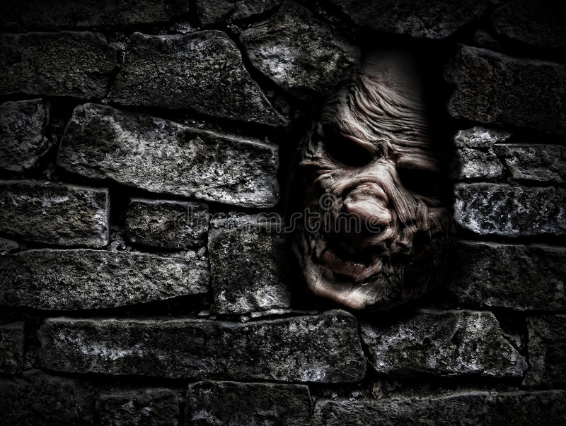 Monster behind the wall stock image
