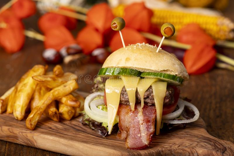Monster burger for halloween. On wood royalty free stock photo