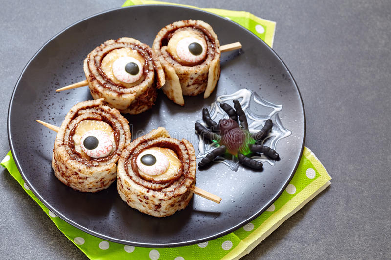 Monster Eyes for Halloween. Crepes roll up with banana royalty free stock photo