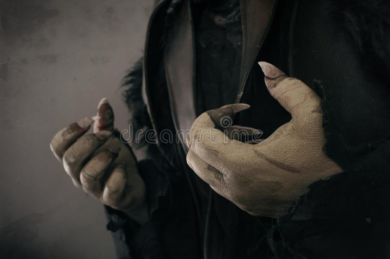 Monster hands with large scary nails stock images