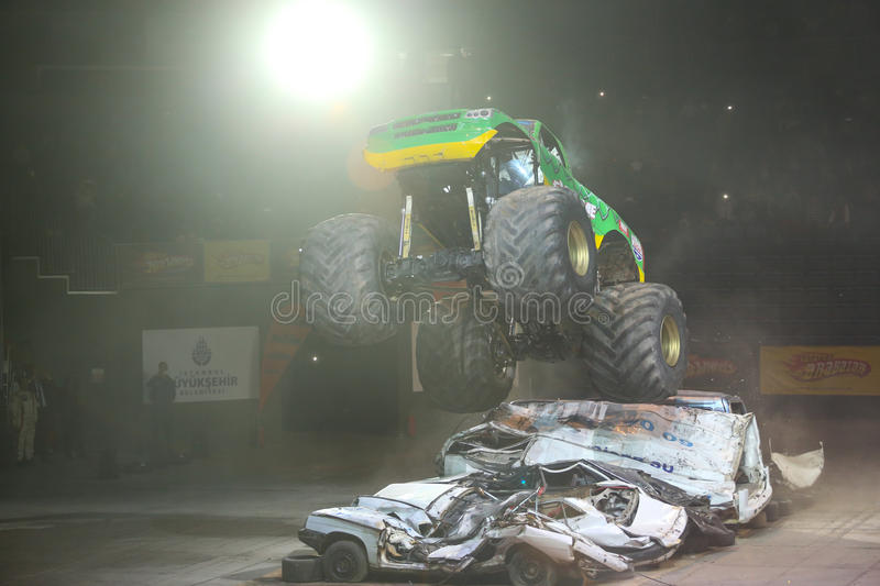 Monster Hot Wheels. ISTANBUL, TURKEY - FEBRUARY 01, 2015: Monster Truck Extreme Revisited crush to old cars in Sinan Erdem Dome during Monster Hot Wheels stunt stock photos
