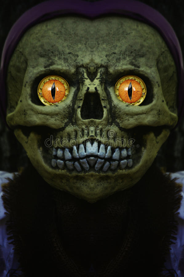 Monster. A skeletal monster with glowing yellow eyes and scary features for Halloween royalty free stock photos