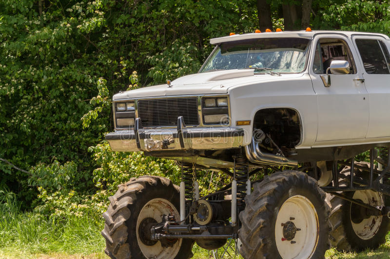 Monster truck. A white pickup truck modified as a monster truck royalty free stock photo