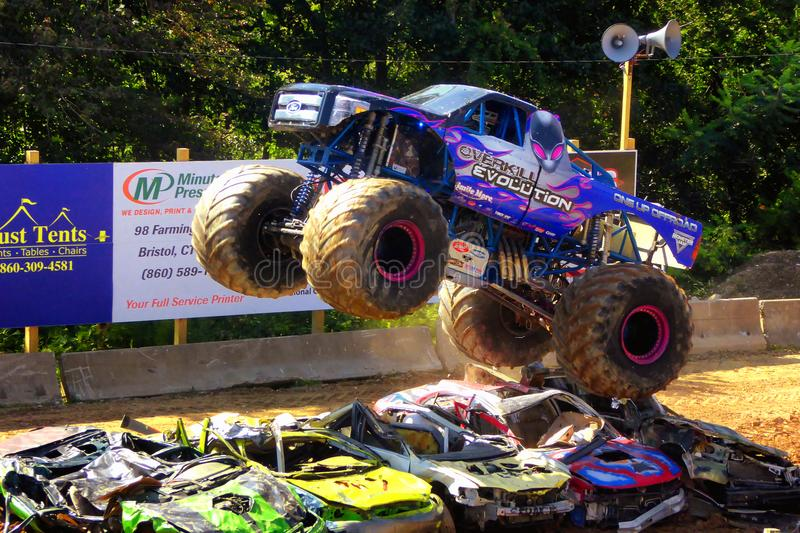Monster trucks show. A big monster truck crushing cars in 105th annual goshen fair in torrington connecticut united states stock photos
