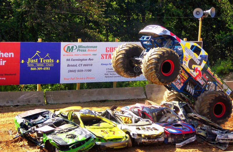 Monster trucks show. A big monster truck crushing cars in 105th annual goshen fair in torrington connecticut united states stock image