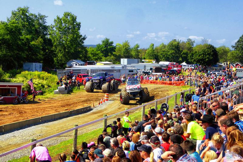 Monster trucks show. People watching monster trucks show in 105th annual goshen fair in torrington connecticut united states royalty free stock image