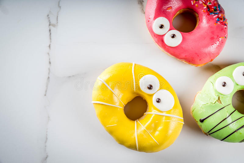 Monsters donuts for Halloween stock photo